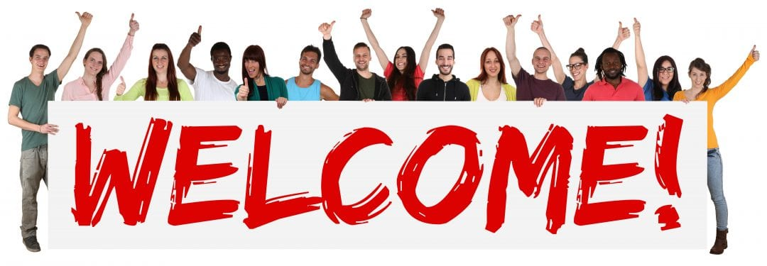 Welcome Sign Group Of Young Multi Ethnic People Holding